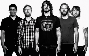 Foo Fighters band members starting from the left: Pat Smear, Nate Mendell, Dave Grohl, Taylor Hawkins, and Chris Shiflett. Courtesy of Consequence of Sound.