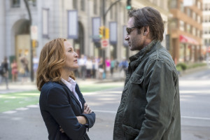 """Gillian Anderson and David Duchvony reprising their roles as FBI Agents Scully and Mulder; still shot from """"My Struggle"""" Photo by IB Times."""