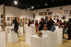 Attendees looking at various arts in the gallery. Photo by Chris DiBella.